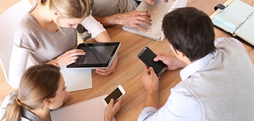 Group-of-business-people-using-electronic-devices-at-work.jpg